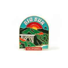 """California Collection   Item No. 1: This soft enamel pin features the iconic Bixby Creek Bridge overlooking the Pacific Ocean. Measures 2""""H and features embossed back with 2 military clutches for secure fastening on your leathers, denims, or canvas."""