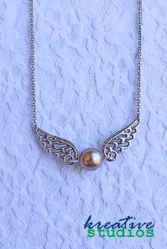 Golden Snitch Necklace - Harry Potter, Quidditch, magic, game, magical, enchanted - American handmade jewelry - http://www.aftcra.com/kreativestudios/listing/15459/golden-snitch-necklace-harry-potter-quidditch-magic-game-magical-enchanted
