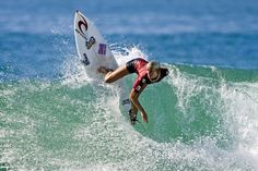 Bethany Hamilton surfing at Huntington Beach CA.   Losing an arm to a shark at age 13 did not stop her from surfing.