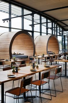 Restaurant Design Ideas – Timber lined barrel booths are positioned along one of the walls of windows in this restaurant, creating a semi-private dining experience, and referencing the wine barrels used within the winery. Bar Interior, Restaurant Interior Design, Interior Design Living Room, Restaurant Furniture, Industrial Restaurant Design, Wine Shop Interior, Resturant Interior, Industrial Office, Modern Industrial