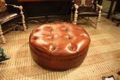 Brown leather tufted ottoman