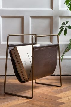 A handy storage solution for your living rooms, bedrooms and hallways the Leather Magazine Holder with Brass Metal available at Rockett St George
