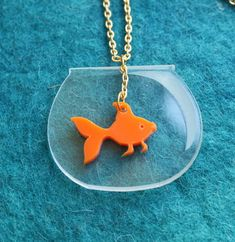Don't we all had a goldfish when we were kids....This plexiglass goldfish pendant is attached to gold plated delicate long chain of 1 mts(39.4 inches) .Plexiglass thickness is 3 mm the pendant size ;  Aquarium width 4.5 cm (1.8 inches)  length :4 cm (1.6 inches)    Fish width: 2.5 cm (1 inch)  le...