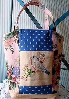 Using vintage pieces to make a bag. I love this idea!