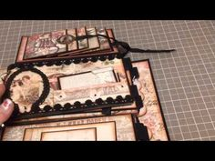 ▶ Prima's Fairy Rhymes paperbag mini album - YouTube.  OMG, I love this idea!