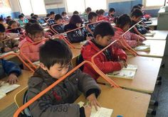 Bars/railings installed on school desks at a primary school in Wuhan, China help students develop good habits and discourage the… School Desks, Study Habits, Rich Kids, Wuhan, Chinese Culture, Roller Coaster, Primary School, Funny Pictures, Knowledge