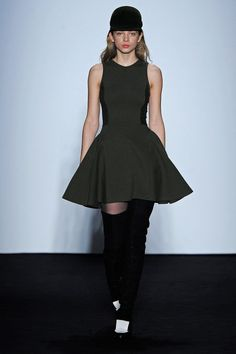 The fit and flare spring trend continues in dark olive with over the knee boots (Timo Weiland)