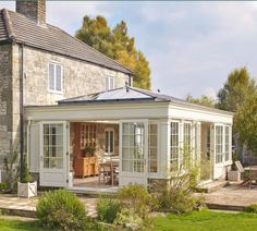 30 Bright and Beautiful Sunroom's Farmhouse Design Ideas Do you want to try a new inspiration for your home? or maybe your house has long you do not renovate and want your renovation. Or maybe your house lacks the intake of more light to keep your house … Garden Room Extensions, House Extensions, Orangerie Extension, Orangery Extension Kitchen, Conservatory Extension, Orangery Conservatory, Sunroom Addition, Sunroom Decorating, Farmhouse Design