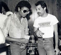 Freddie Mercury and Michael Jackson | I wonder what they are talking about | brilliant artists in their own right | famous musicians and performers | ray bans | soda and beer | party | 1970's fashion | velour shirt | black & white | discussion | chat | iconic | history | fro | afro | RIP | moustache | listen | talk | converse
