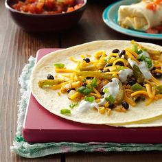 Corn, Rice & Bean Burritos Recipe -No one will miss the meat when you dish up these satisfying burritos bursting with a fresh-tasting filling. They're fast to fix and won't put a dent in your wallet. —Sharon W. Bickett, Chester, South Carolina