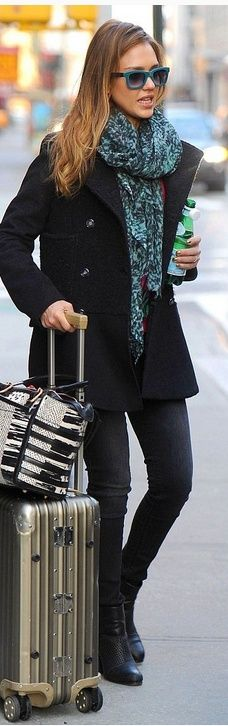 Who made Jessica Alba's blue print scarf, skinny black jeans, print handbag, and black boots? Purse – Christian Louboutin  Shoes – Rag & Bone  Jeans – Black Orchid  Scarf – Saloni London