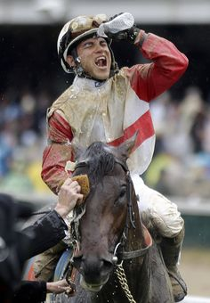 Joel Rosario celebrates after riding Orb to victory in the 139th Kentucky Derby at Churchill Downs Saturday, May 4, 2013, in Louisville, Ky.