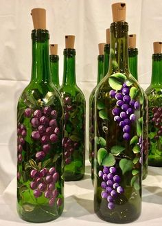 **Made to Order** Brighten your home with this wine bottle light, hand painted with beautiful grape vines and illuminated with with battery powered cork lights. This design can be done with red or purple grapes, your choice. The bottle is painted with enamel paint and oven cured #paintedwinebottles #artsandcrafts