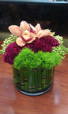 A colorful combination of flowers and textures, perfect for centerpiece for the sophisticated Bride