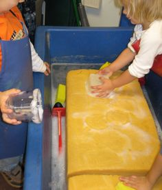 SAND AND WATER TABLES ... Check out this inspiring website.  Anyone throwing out an old sofa cushion?!