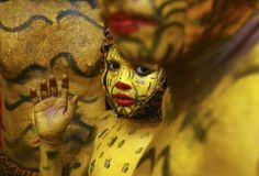 A boy with his body painted like a tiger waits backstage during festivities marking the annual harvest festival of Onam in the southern Indian city of Kochi. Description from blogs.voanews.com. I searched for this on bing.com/images