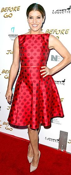Lovely lady in red! The Bad Judge actress looked delightful in a polka-dot Talbot Runhof dress with nude pumps.