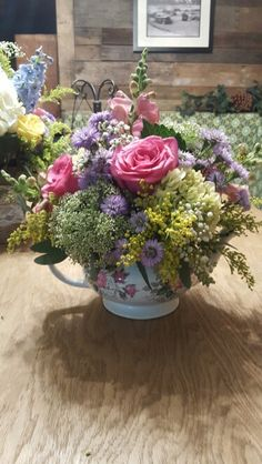 Vintage teapot centerpiece with roses, snaps, solidago, queen Anne's lace and seeded eucalyptus.