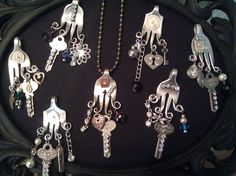 Old forks turned into charm necklaces...with vintage keys and baubles