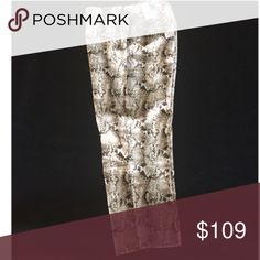 WhiteHouseBlackMarket Snake Skin Print Ankle Pants Ivory, Brown, and Black - great neutral colors. Snake skin print. 97% cotton/ 3% Spandex. Size 10 Regular. Also have size 10 Short available in a separate listing. White House Black Market Pants Ankle & Cropped