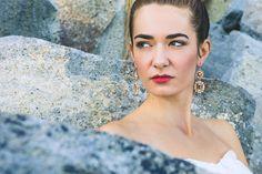 Bride and Stones - shot of a bride in a rocks