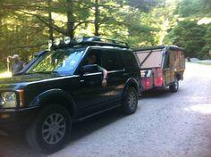 Dendy driving his Land Rover with a Conqueror Commander trailer