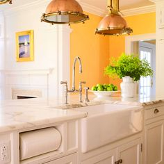 Paper towels are discreetly tucked into a built-in dispenser to the left of the sink, right under the counter-one of architectural designer Louise Brooks's clever trademark solutions.