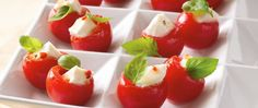 Colorful cherry tomatoes hold Italian-seasoned mozzarella cubes in this four-ingredient, 15 minute recipe.