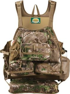 Stay hidden on your next turkey hunt with the Cabela's ColorPhase Super Tat'r™ III Turkey Vest. ColorPhase changes with the temperature - keeping you hidden in the hot sun and the cool shade. Turkey Hunting Vest, Hunting Camo, Hunting Guns, Hunting Stuff, Hunting Packs, Outdoorsy Style, Cool Gear, Hunting Clothes