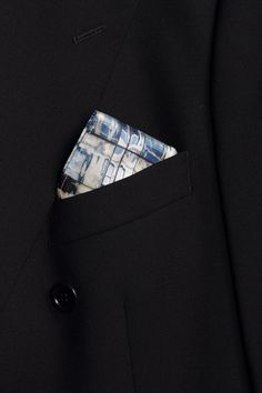 Wall Street   Stride with confidence with this striking pattern comprised of the melodious colors of blue and white. This pocket square is the perfect piece to bring together your overall style; this piece translates perfectly to the skyscrapers of the concrete jungle known as New York. Jean Michel's signature pattern created from the reflections of buildings creates a salient look that works together to create a dashing first impression.