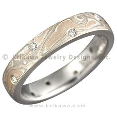 Champagne Mokume Wedding Band with Scattered Diamonds - This band is our classic mokume band but with the addition of 12 flush set round diamonds (0.12 ctw ideal cut) scattered around the band.    - This designer wedding band is inlaid with Champagne mokume. It has a an etch and matte finish.