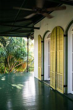 shades of green on a wraparound porch (Ernest Hemingway's key west estate)