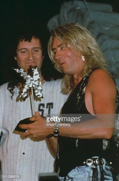 brian-may-of-queen-and-joe-elliott-of-def-leppard-kerrang-awards-picture-id531286819 (392×594)