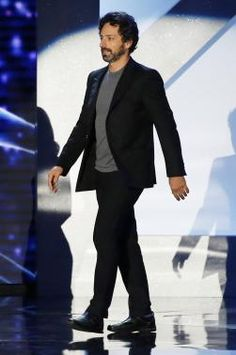 Google Inc. co-founder Sergey Brin walks on stage during the second annual Breakthrough Prize Awards at the NASA Ames Research Center in Mountain View, California, November 9, 2014. REUTERS-Stephen Lam