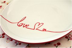 thrift a plain plate, write your message with a porcelain pen (make breakfast on it and leave it for the one you love..)