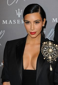 gold-eye-makeup-kim-kardashian...I think she usually wears way too much makeup, but this look is really pretty. Softer on the eyes and coral red lips...