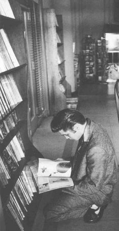 Elvis Presley checking out the latest magazines.