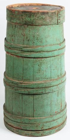 A wonderful stave churn with laced finger bands and original wood top. Great old original paint.