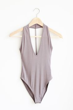 """- Details - Size - Shipping - • 94% Rayon 6% Spandex • Rib halter bodysuit with button snap closure. • Hand Wash • Line dry • Made in USA • Measured from small • Length 25.5"""" • Chest 14"""" • Waist 13"""" -"""
