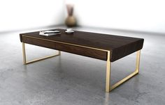 Ravishing Minimalist Decor Makes A Bold Visual Impact With Understated Class Smart wooden coffee table makes a bold visual impact RKNL Coffee Table Legs, Brass Coffee Table, Coffee And End Tables, Coffee Table Design, At Home Furniture Store, Table Furniture, Furniture Design, Office Furniture, Centre Table Design