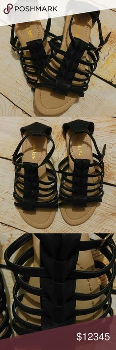 Black gladiator sandals strappy like new Black with a tan sole. I wore them one time. Great condition! A soft suede material. Buckles on the side. Sophia & Kate Shoes Sandals