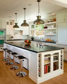 White cabinet with Black Granite Counter-top. This is a very nice ceiling incidently! Counter more open however.