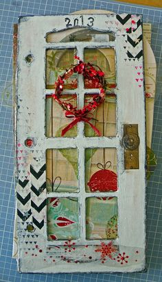 December Daily. Let the year be the number on the door cover for a journal with highlights from that year.