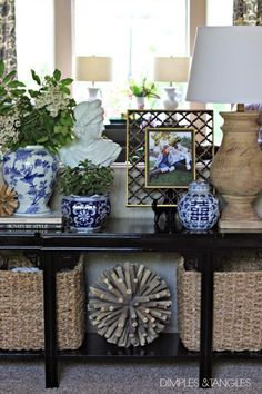 NEW SOFA TABLE STYLED 3 WAYS Love the color combo, blue/white pottery and natural elements with black table.Love the color combo, blue/white pottery and natural elements with black table. Sofa Table Styling, Sofa Table Decor, Sofa Tables, Table Decorations, Entry Tables, Console Table, Food Decoration, Unique Home Decor, Cheap Home Decor