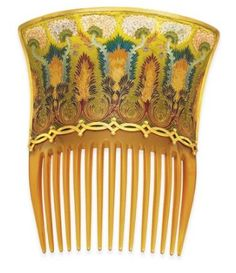 One of a pair of art nouveau tortoiseshell hair combs with plique-à-jour enamel flowers and foliate scrolling detail by Braquemond. There is scalloped 18K gold trim, and it is mounted in enamel. These combs formed part of a toilet set for Baron Joseph Vitta, who lived in Paris, and was an important art nouveau patron. c.1900. est: $ 50,000 – $ 70,000