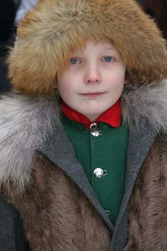Saami girl in fur trimmed hat at the traditional sami craft market, Jokkmokk, Sweden. Size to A4.: Sami, Jokkmokk Market: Arctic & Antarctic photographs, pictures & images from Bryan & Cherry Alexander Photography.