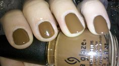 """Mahogany Magic"" by China Glaze from the ""Capital Colours"" Hunger Games Collection (District 7 - Lumber). Reminds me. Totally looks like milk chocolate on the nails. Yummy!"