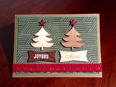 Handmade Christmas card with wooden accents and inked stars.