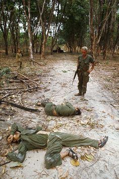 ca. 1969, near Michelin, Vietnam --- Two dead North Vietnamese army soldiers killed in action near Michelin, Vietnam. --- Image by © Tim Page/Corbis