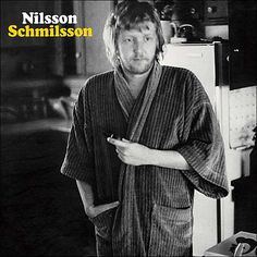 The cover of Harry Nilsson's most critically acclaimed album, Nilsson Schmilsson, shows a disheveled Nilsson wearing a robe, one hand in his pocket and the other holding a hash pipe. The album title and cover are perfect illustrations of [. John Lennon, Lps, Elvis Presley, Michel Polnareff, Ill Never Leave You, Harry Nilsson, Into The Fire, Out Of Touch, Rca Records